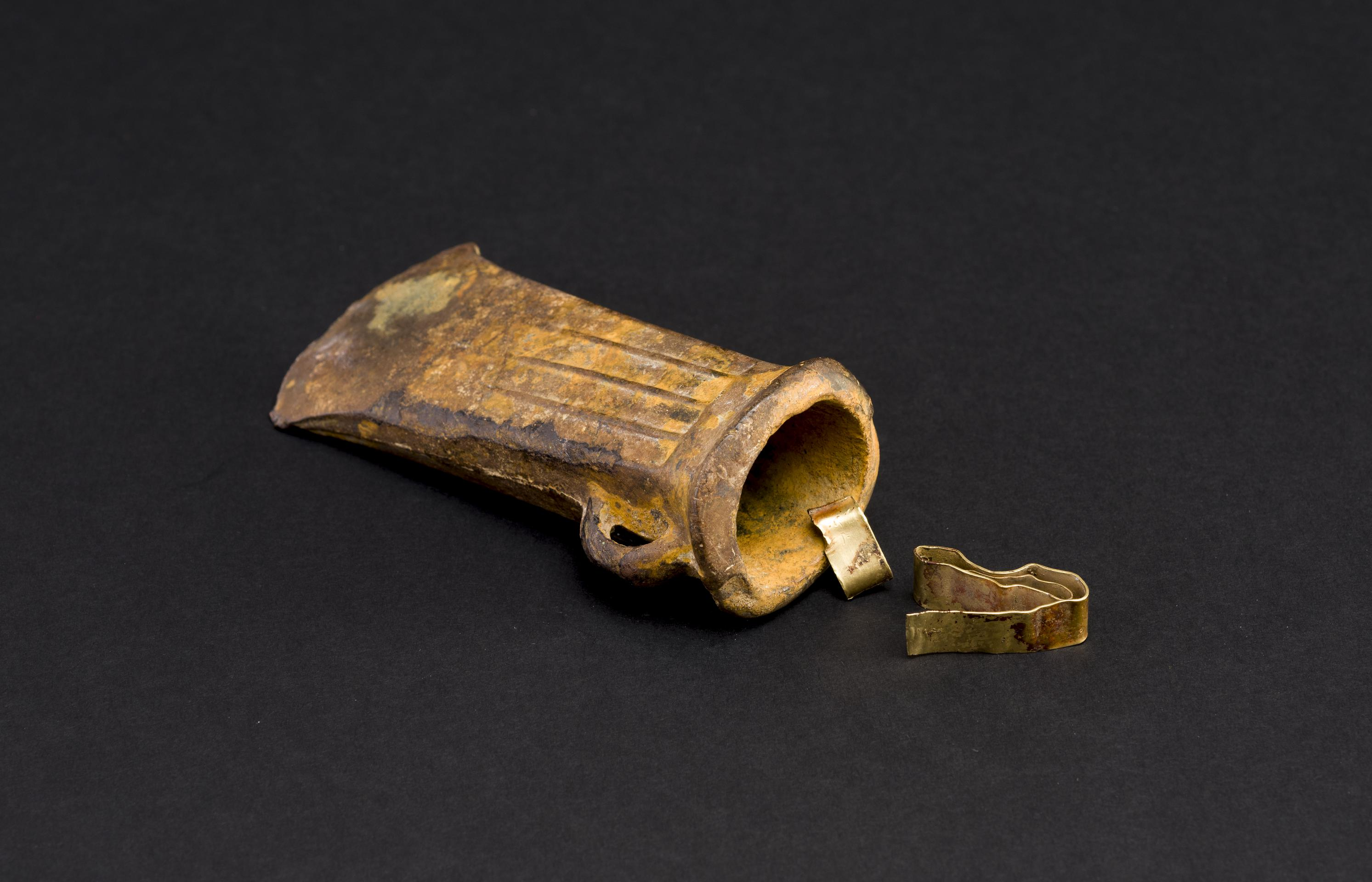 Open the image 'Late Bronze Age - ribbed bronze socketed axe, gold bracelet and ribbon fragment hoard group'