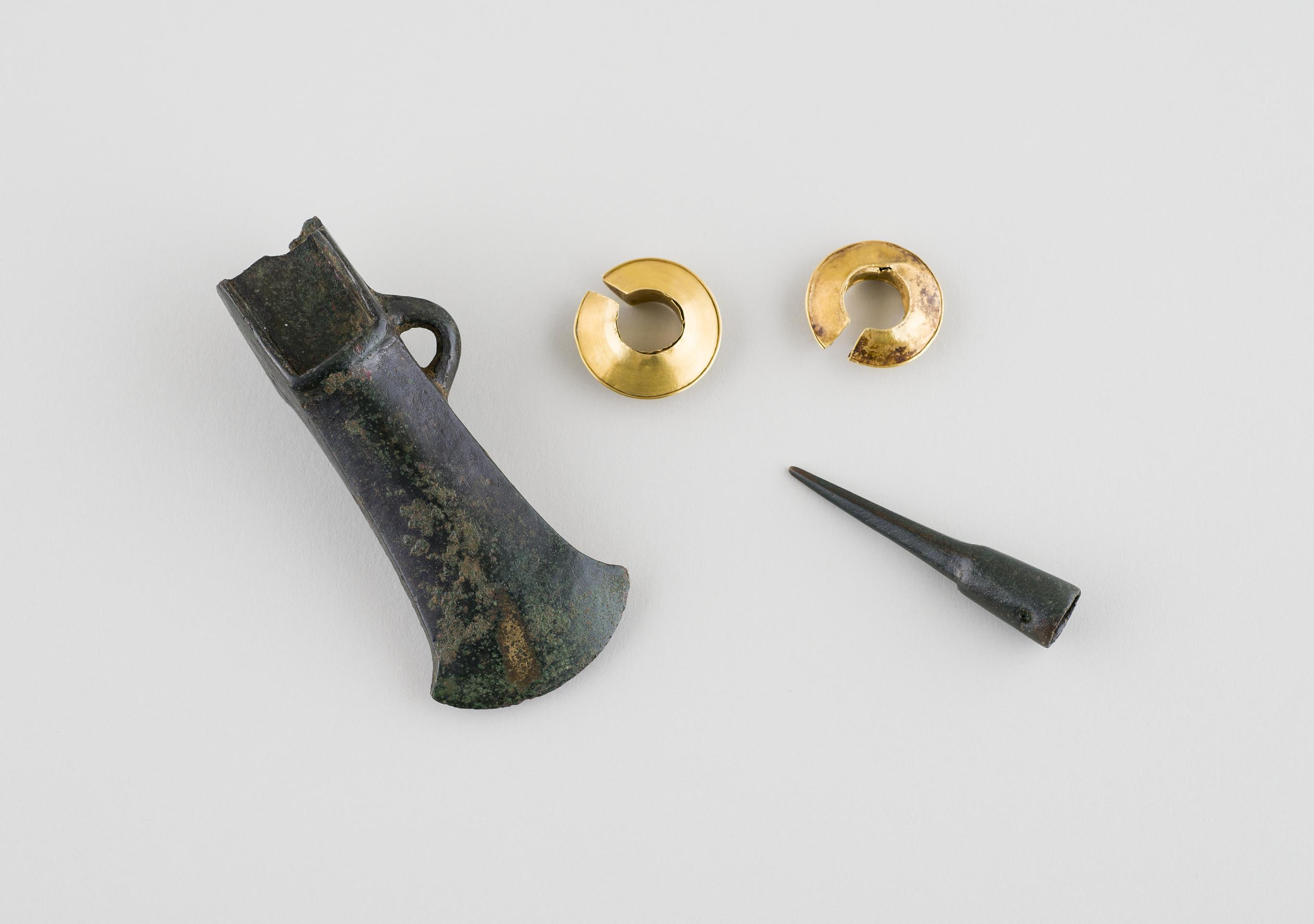 Open the image &lsquoTwo gold lock-rings, bronze palstave, bronze awl'