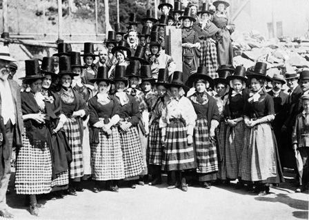 Women in Welsh dress greeting visitors, 30th August, 1909