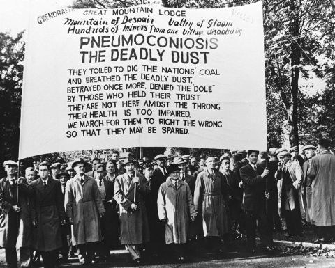 Pneumoconiosis banner in NUM march, 1952 (b/w photo)
