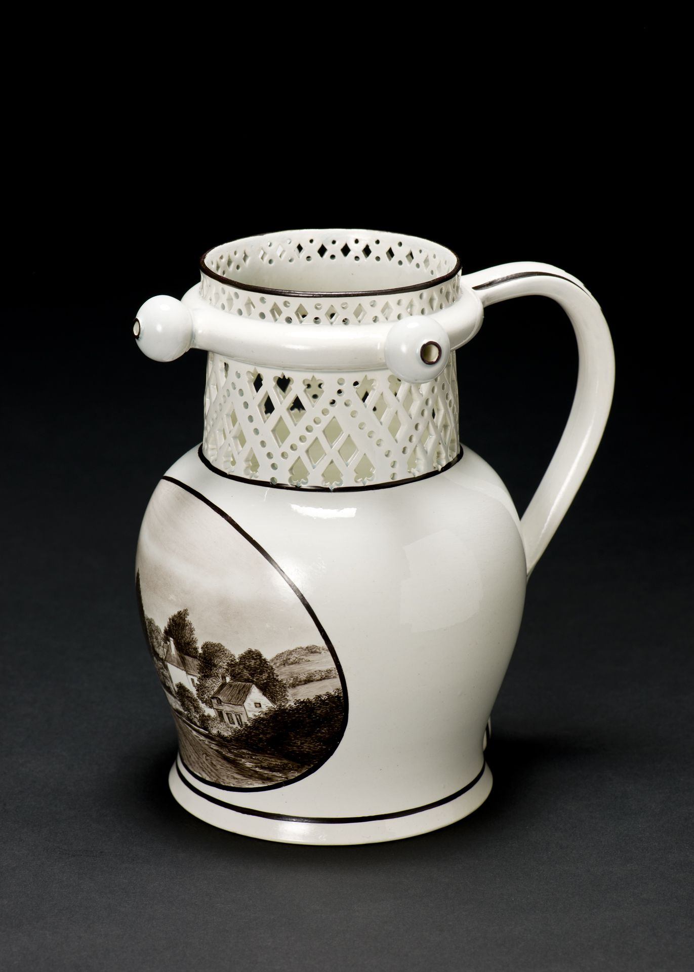 Jug with a cut out trellis-like design of circles and lozenges at the top, with a ring around neck from which protrude three bulbous spouts.