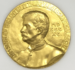 photograph of a gold medal with the portrait of man's head in profile