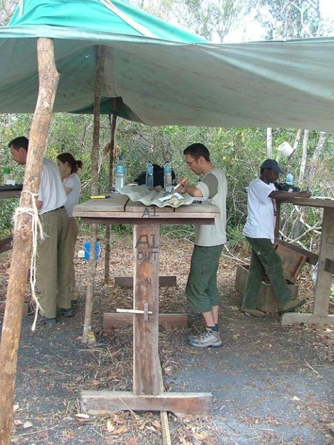 Taking samples from cores of mud at the drill site in Tanzania.